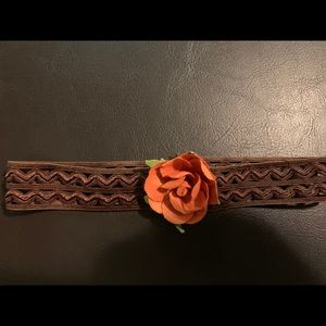 Other - Brown headband with small orange flower